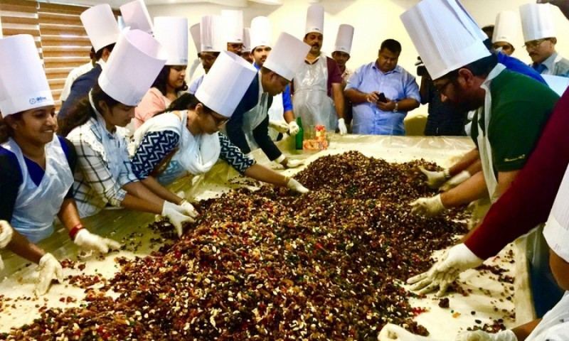 Olive Downtown Hosts Cake Mixing Ceremony